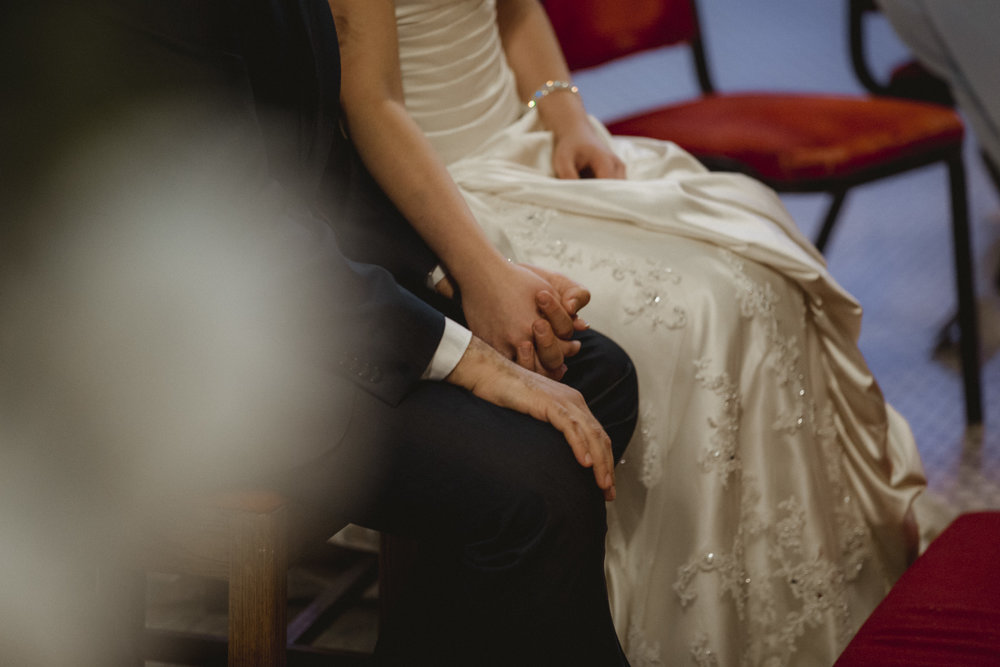 Bride and Groom hold hands during the ceremony | Our Lady of Pompeii wedding | Manhattan wedding | Bronx Wedding | Cathy & Antonello's wedding | Amy Sims Photography