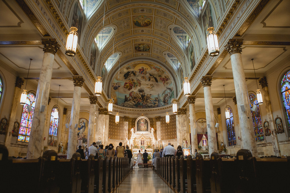 Interior view of church with ornate stained glass windows, marble columns, and domed ceiling | Our Lady of Pompeii wedding | Manhattan wedding | Bronx Wedding | Cathy & Antonello's wedding | Amy Sims Photography