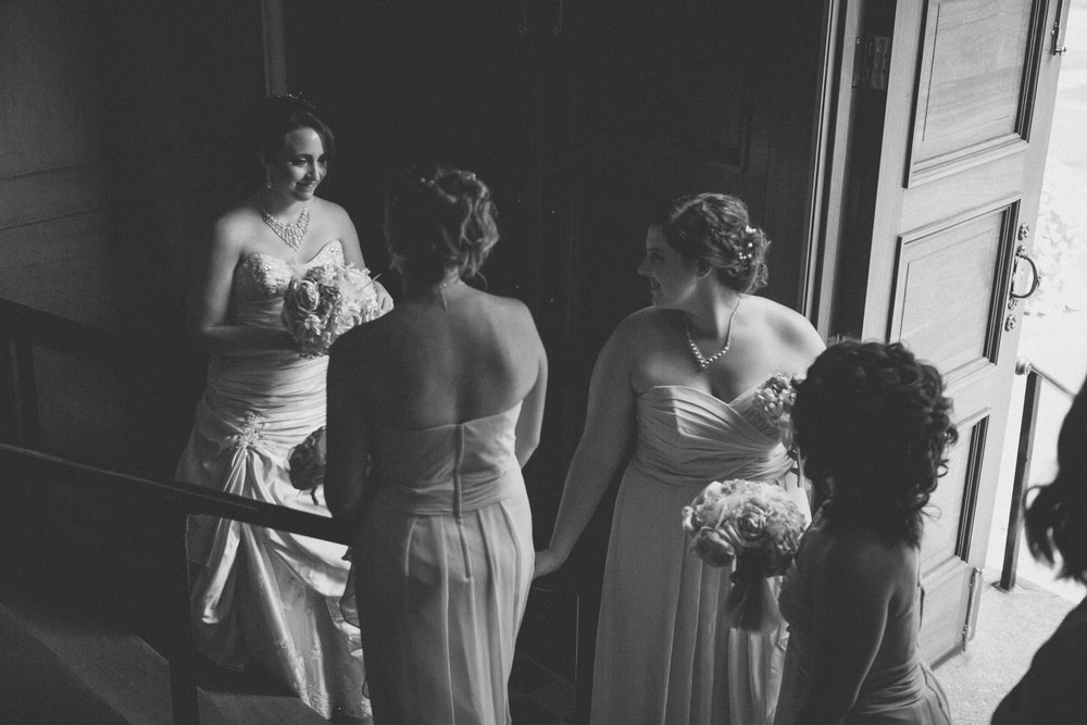 Bridesmaids look adoringly at bride while waiting on the steps, moments before the ceremony | Our Lady of Pompeii wedding | Manhattan wedding | Bronx Wedding | Cathy & Antonello's wedding | Amy Sims Photography