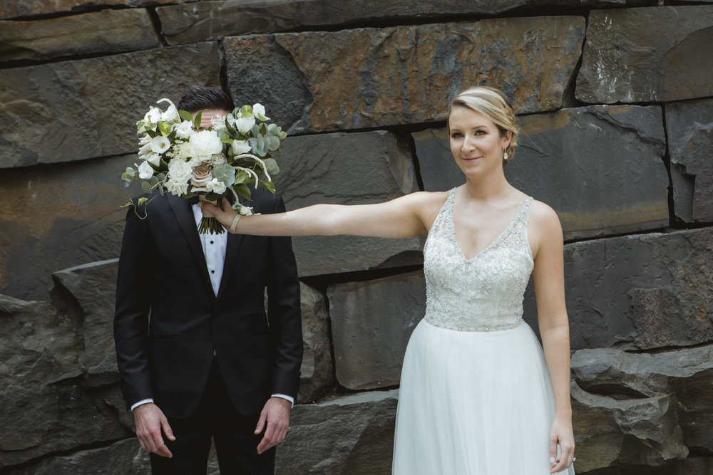 Amy Sims Photography | Bride smiles coyly while holding bouquet in front of groom's face | New York Wedding Photographer | Manhattan Wedding Photographer