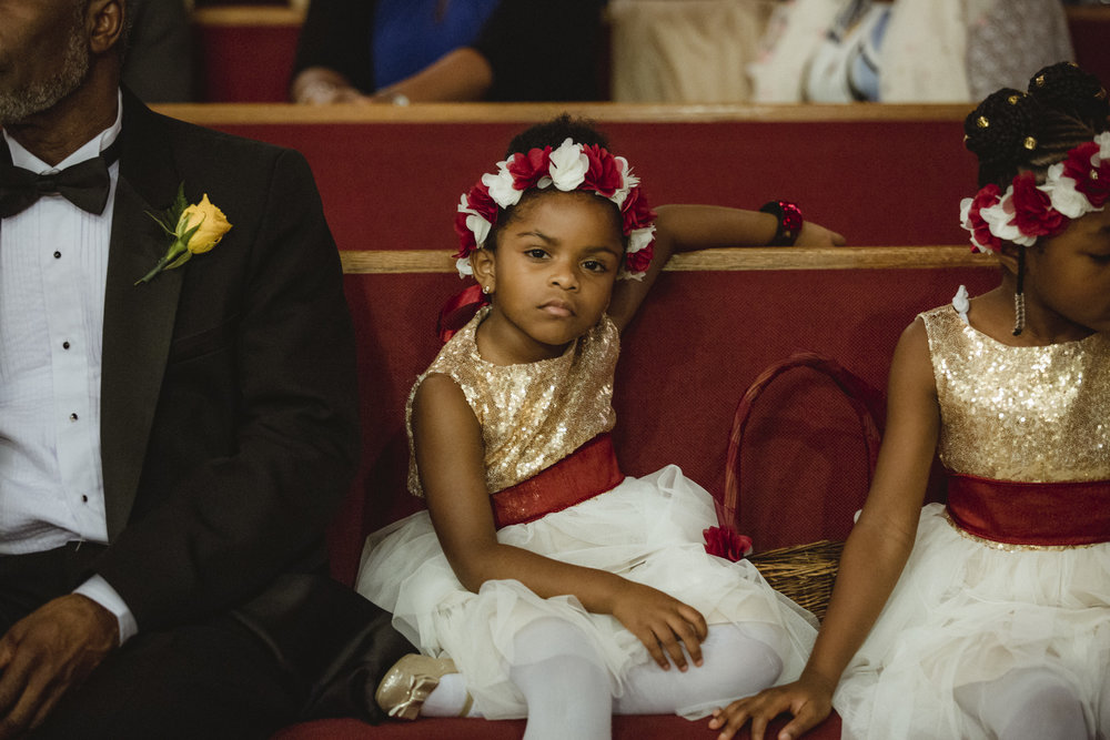 Amy Sims Photography | Flower girl sits cooly during ceremony | Brooklyn Wedding Photographer