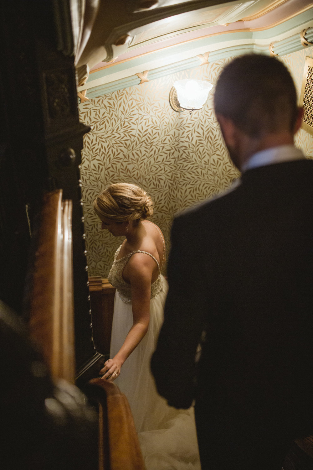 Amy Sims Photography | bride and groom walk down narrow stairs surrounded by detailed ornate wallpaper | Weylin Wedding | Brooklyn Wedding Photographer