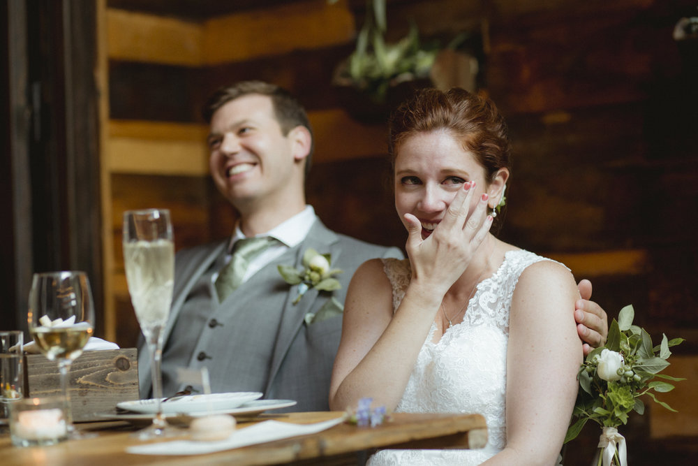 Amy Sims Photography | Bride wipes away a tear while bride and groom laugh | Brooklyn Winery Wedding | Brooklyn Wedding Photographer