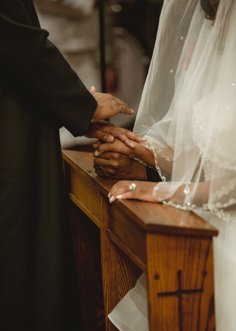 Amy Sims Photography | close up of pastor's hands resting on top of the bride and grooms hands in prayer | Brooklyn Wedding Photographer | candid wedding photographer