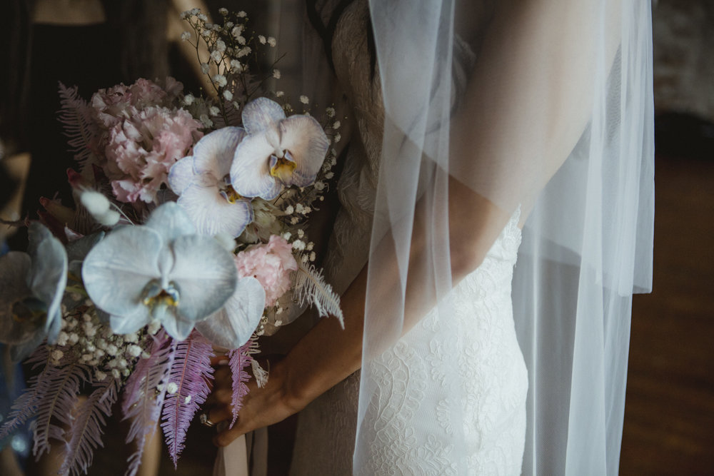 Amy Sims Photography | close up of bride holding her bouquet in a quiet moment before walking down the aisle | Brooklyn Wedding Photographer | Liberty Warehouse Wedding