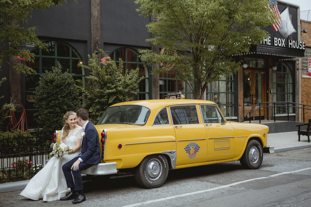 Amy Sims Photography | Bride and groom sit on the back bumper of an old taxi in front of hotel | Box House Hotel Wedding | Brooklyn Wedding Photographer | New York Wedding photographer