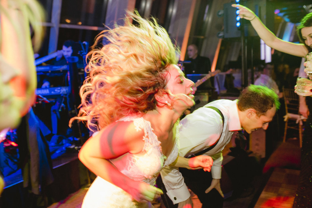 Amy Sims Photography | Bride's hair is wild while bride and groom headbang on the dance floor | NYU wedding | New York Wedding photographer | Manhattan wedding photographer