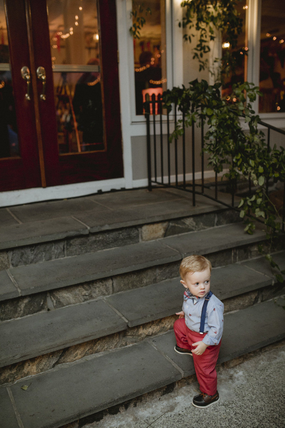 Amy Sims Photography | toddler looks back at dance floor on his way out | Westchester wedding photographer | Hudson Valley Wedding photographer | candid wedding photographer