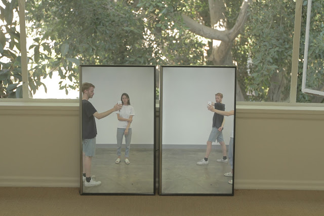 Adelle Mills,  Moving through phone  (installation view), 2015 two-channel video, 12 min 30 sec, silent. Adelle Mills: 3 Day Exhibition, Laurel Doody, Los Angeles, 2015. Courtesy and copyright the artist. Photograph: Adelle Mills.