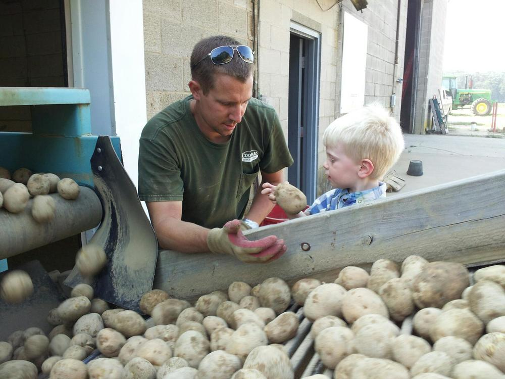 John Jr teaching son Lee about potatoes
