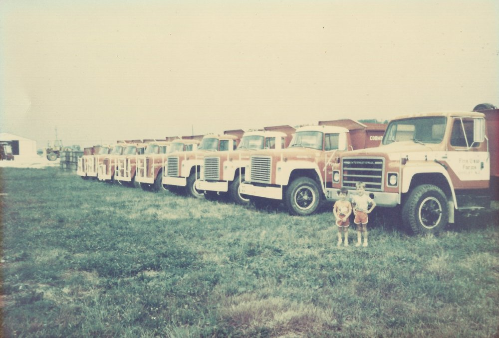 George and John Jr with farm fleet 1987
