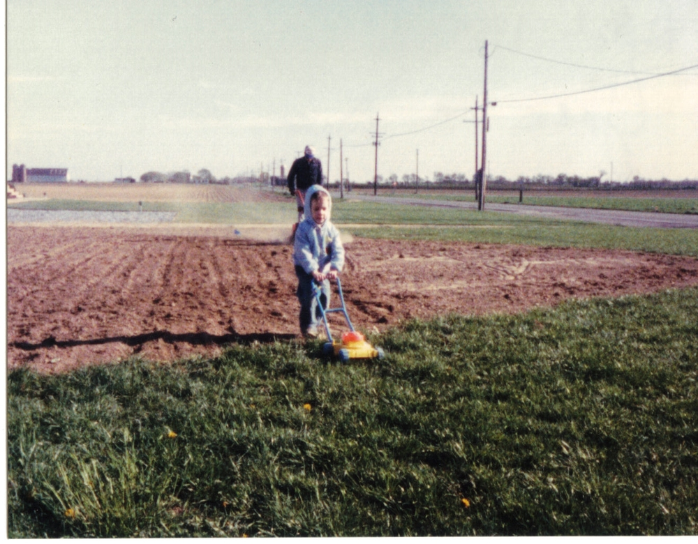 John and John Jr preparing their yard for grass seed in 1986