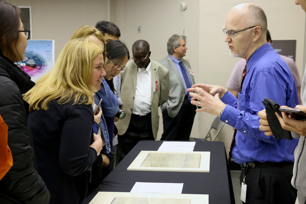 Scholars review historic documents at the Historical Society of Pennsylvania.  Photo by Rachel Meirson