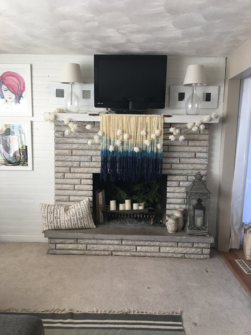 I painted the whole thing white, and I actually really liked it but I wanted a space that I could store wood. So my mind automatically went to a built in style. Then I made the mistake of Pinteresting fire place Reno's and man, there is a lot of talent out there #amirightladies
