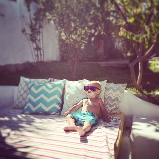 Chillin pool side!!! #anotherhappycamper #kidsallowed #babyboss #poolside #inthegarden