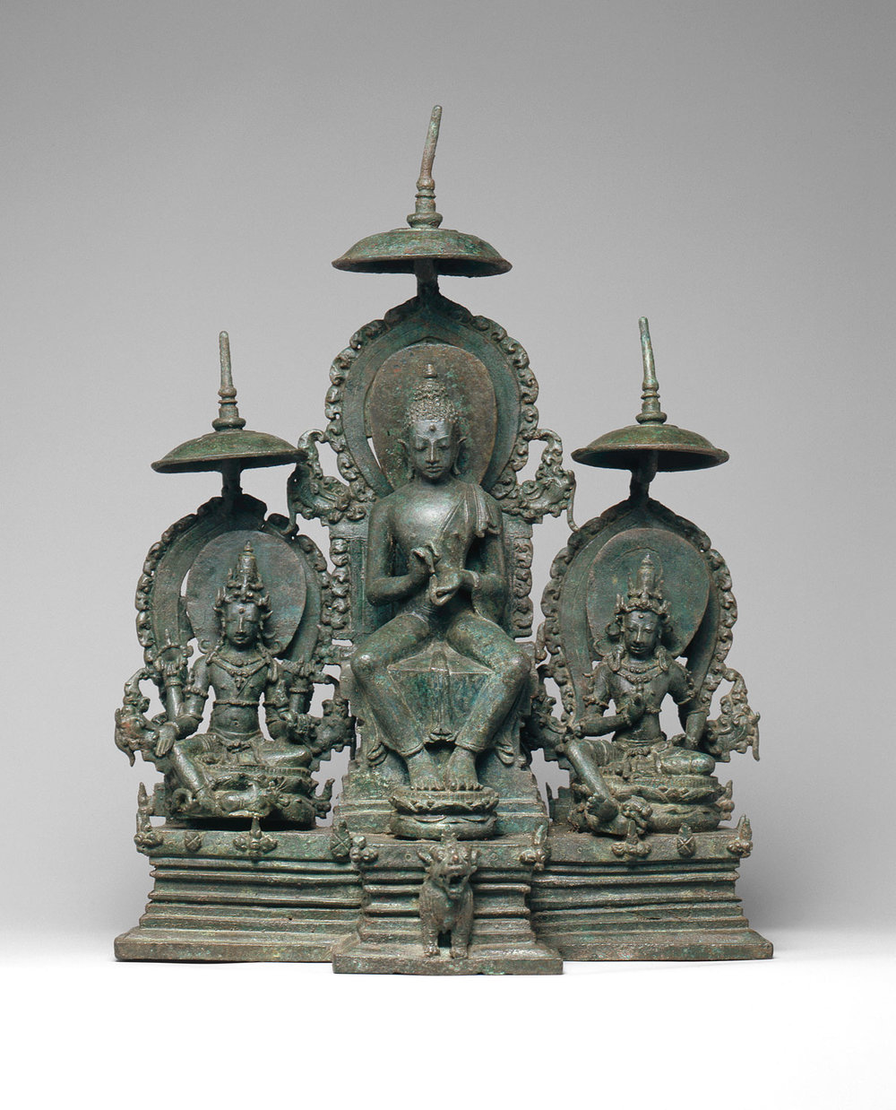 Enthroned Buddha Attended by the Bodhisattvas Avalokiteshvara and Vajrapani. Second half of the 10th century. Early Eastern Javanese period. Indonesia. Image courtesy of  The Met .