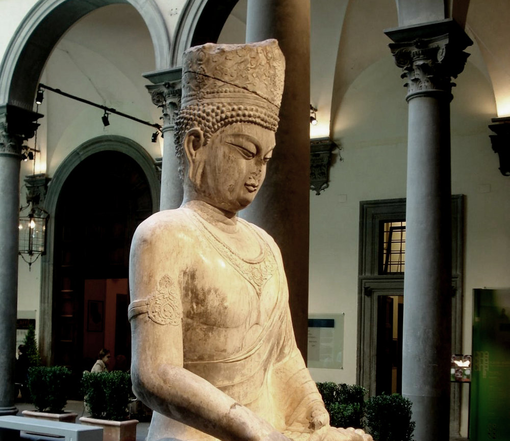 "Statue of Maitreya, originally located in the grottoes of Longmen, carved in the likeness of Empress Wu Zetian during her reign.    Photo taken at the exhibition ""China at the Court of the Emperors: Unknown Masterpieces from Han Tradition to Tang Elegance (25-907)"" at the Palazzo Strozzi in 2008 by Wiki Commons user  Harlock81 ."