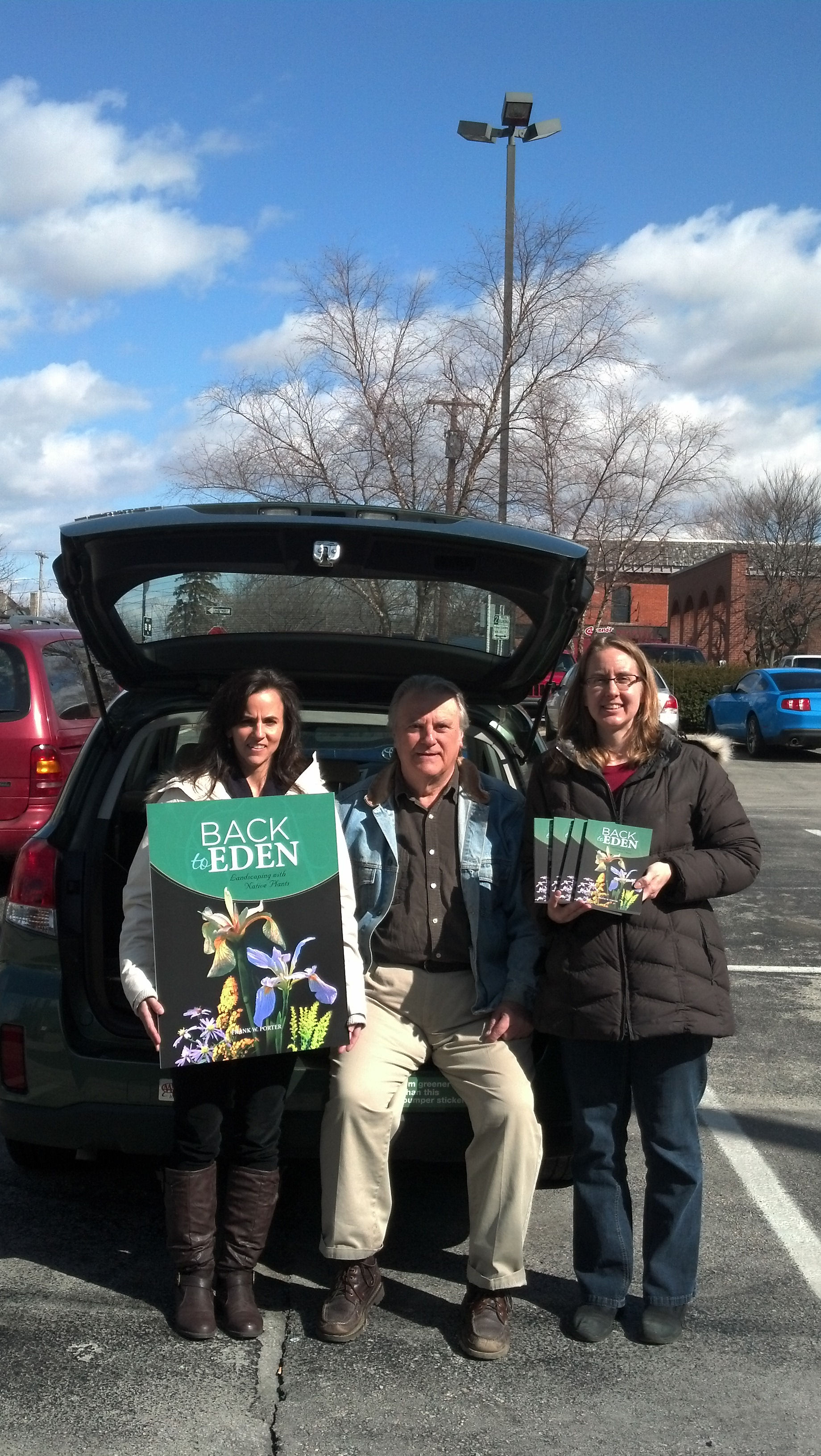 Sarah and Janice help Dr. Porter load up books for his upcoming conference!
