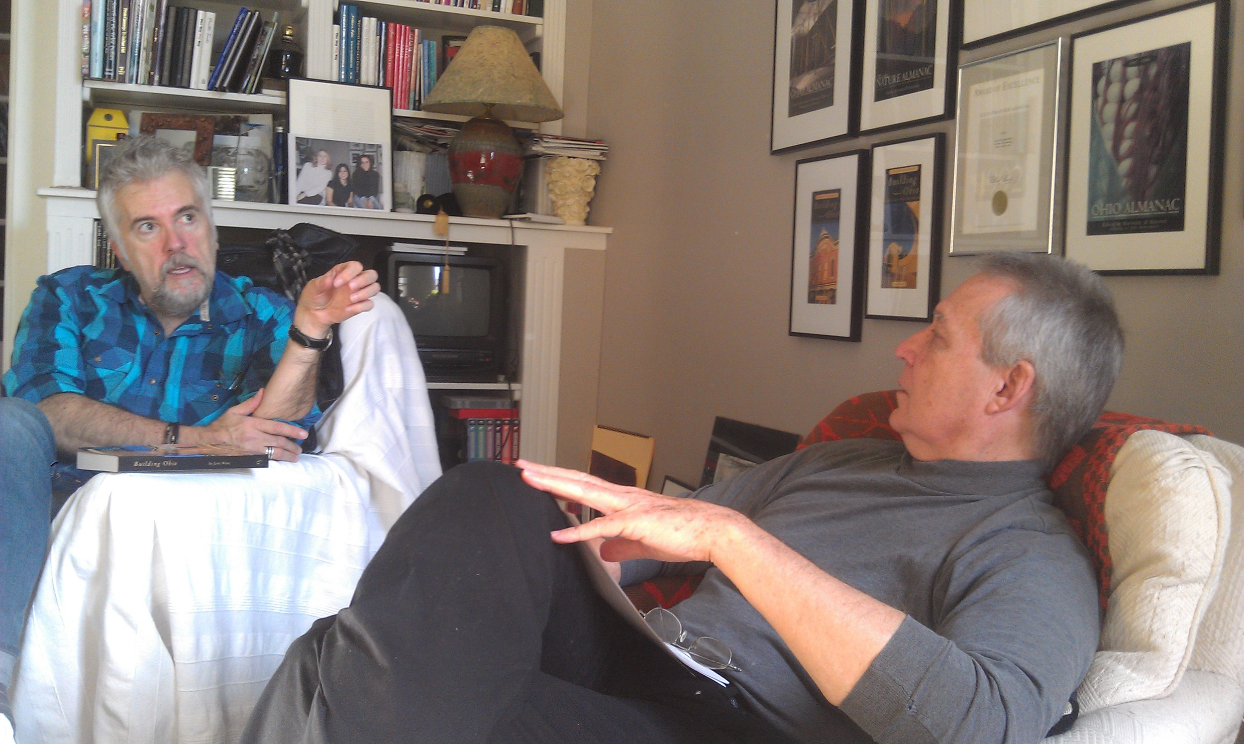 Our editor John Baskin talking over a book project with author Phil Nuxhall.
