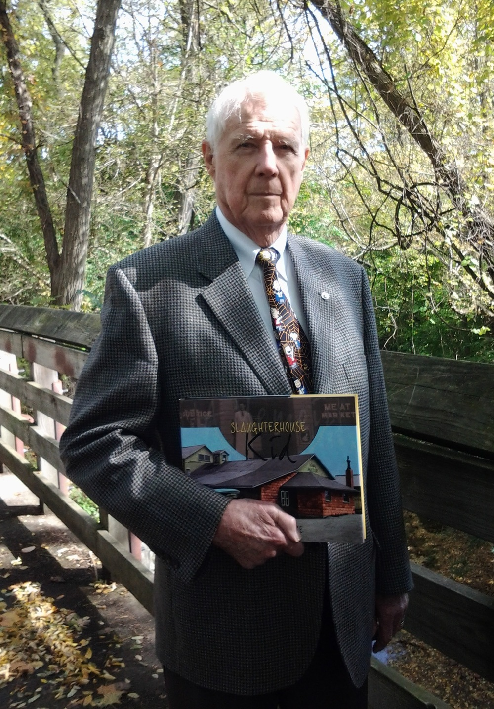 Wendell Cultice with his memoir, Slaughterhouse Kid, a custom book published by Orange Frazer Press