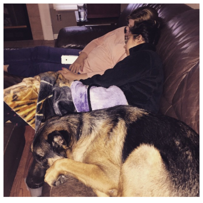 My mom and dog snuggling with me once I was home from the hospital
