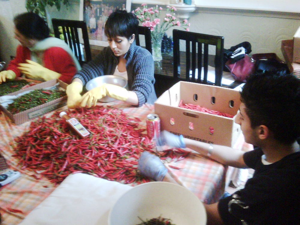 We picked chilli by hand at the dinner table when we began our business