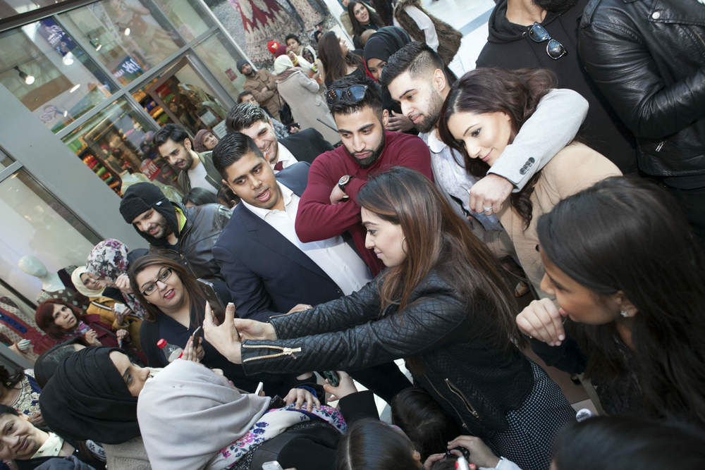 Moses Baig of Desi Rascals with fans.jpg
