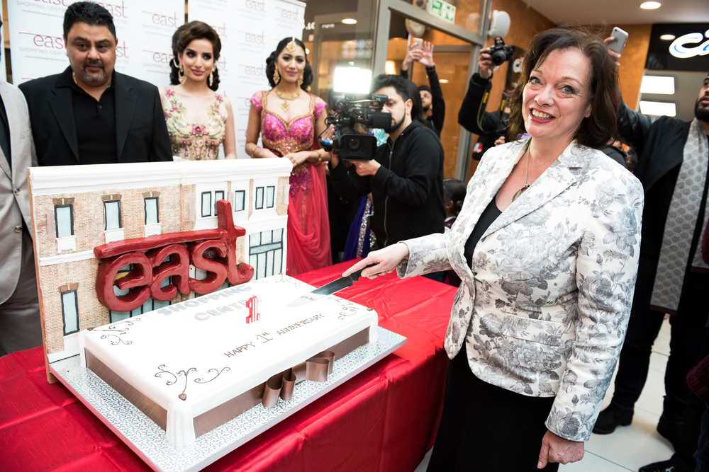 Lyn Brown MP West Ham at East Shopping Centre with the annivesary cake.jpg