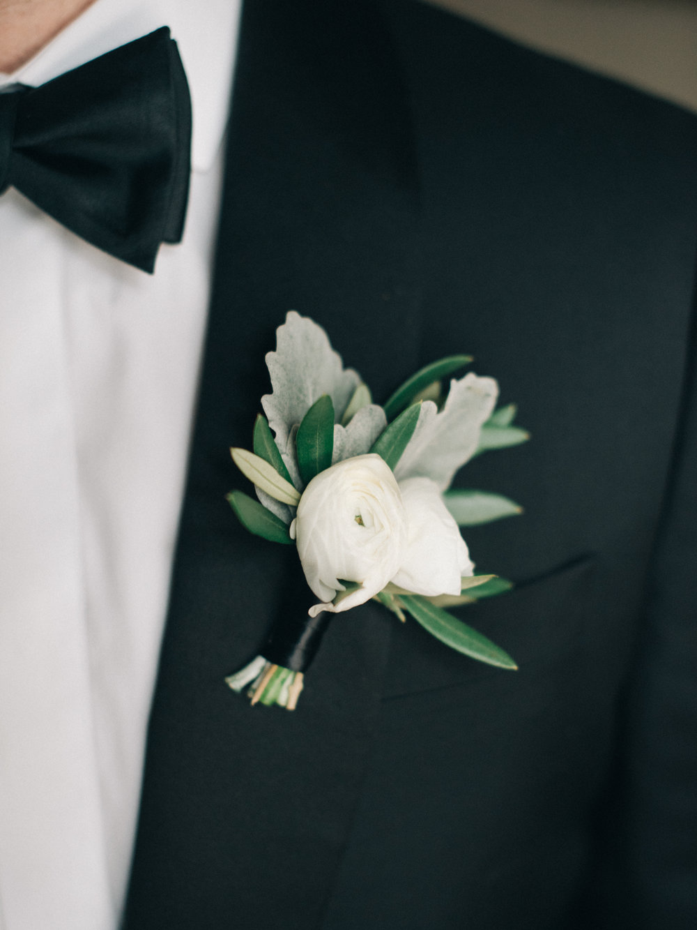 Flowers by Fleur Inc, Planning by Jayne Weddings, Photo by Sean Cook Weddings.  White ranunculus boutonniere.