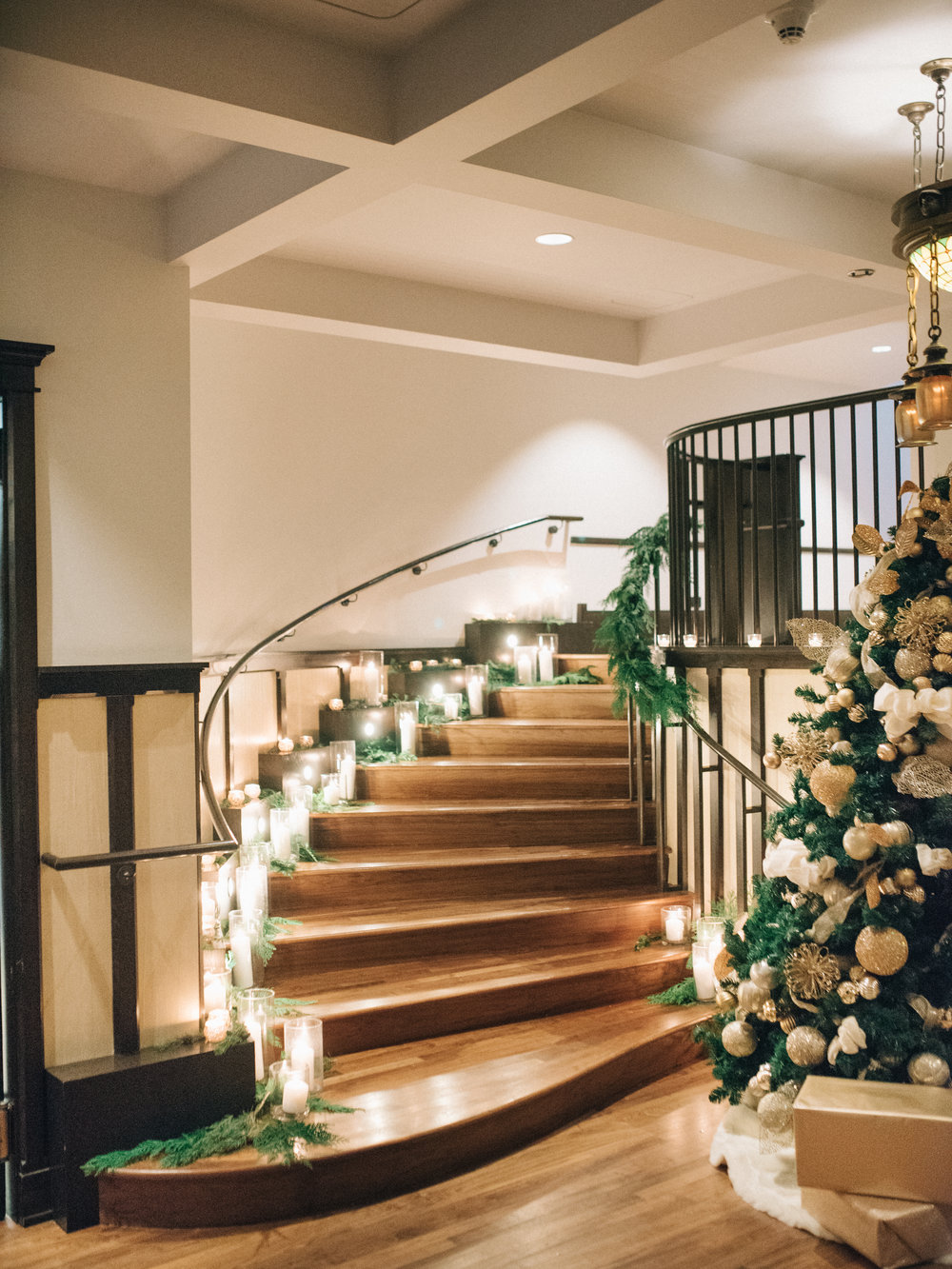 Flowers by Fleur Inc, Planning by Jayne Weddings, Photo by Sean Cook Weddings.  Candlelit staircase.