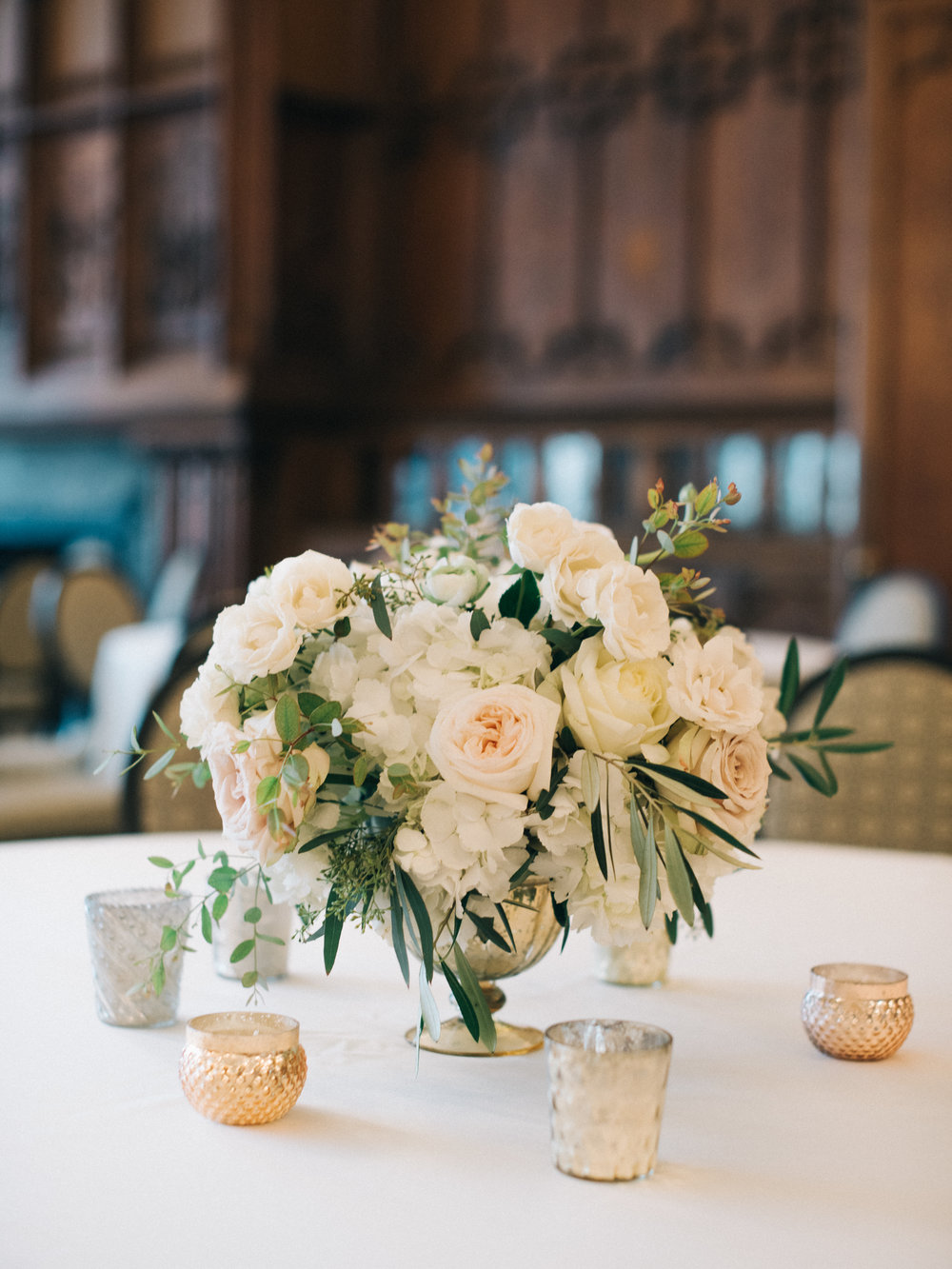 Flowers by Fleur Inc, Planning by Jayne Weddings, Photo by Sean Cook Weddings. Plush ivory centerpiece at the Chicago Athletic Association Hotel