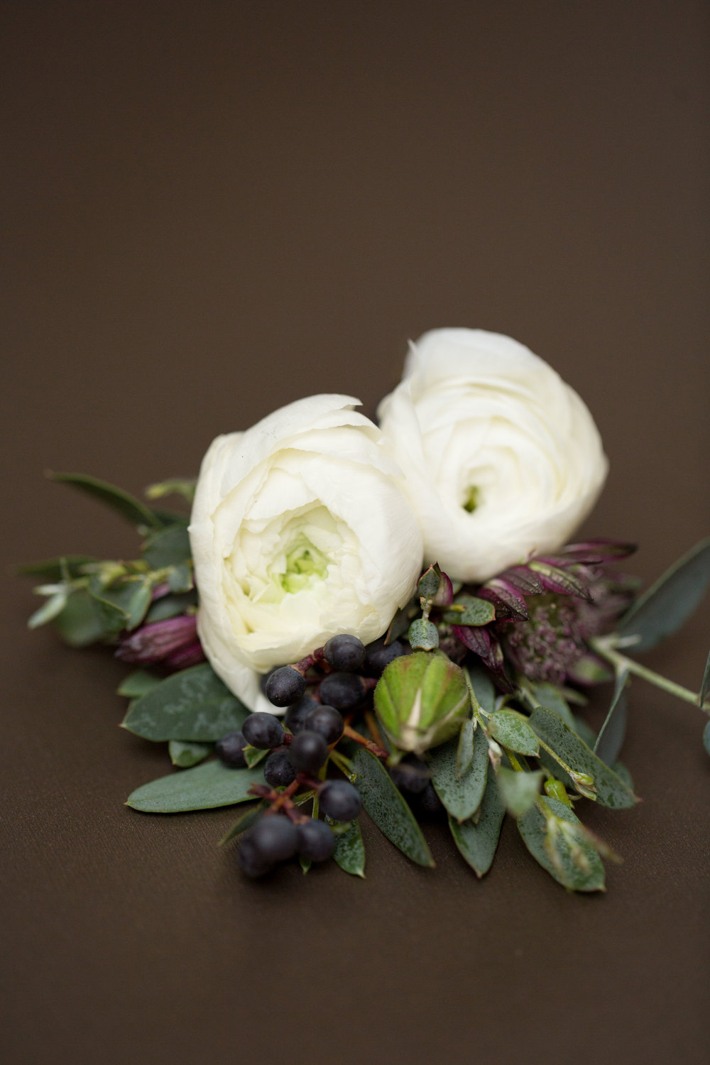 Fleur-Inc-Natalie-Probst-Photography-Lola-Event-Productions-Hotel-Allegro-Ranunculus-boutonniere