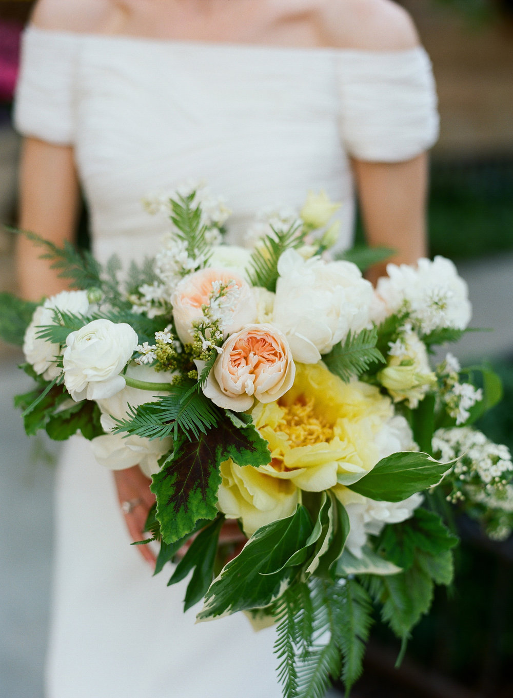 Yellow peony and fern bridal bouquet designed by Fleur Inc.  Wedding at the Chicago History Museum, photographed by Kate Headley.