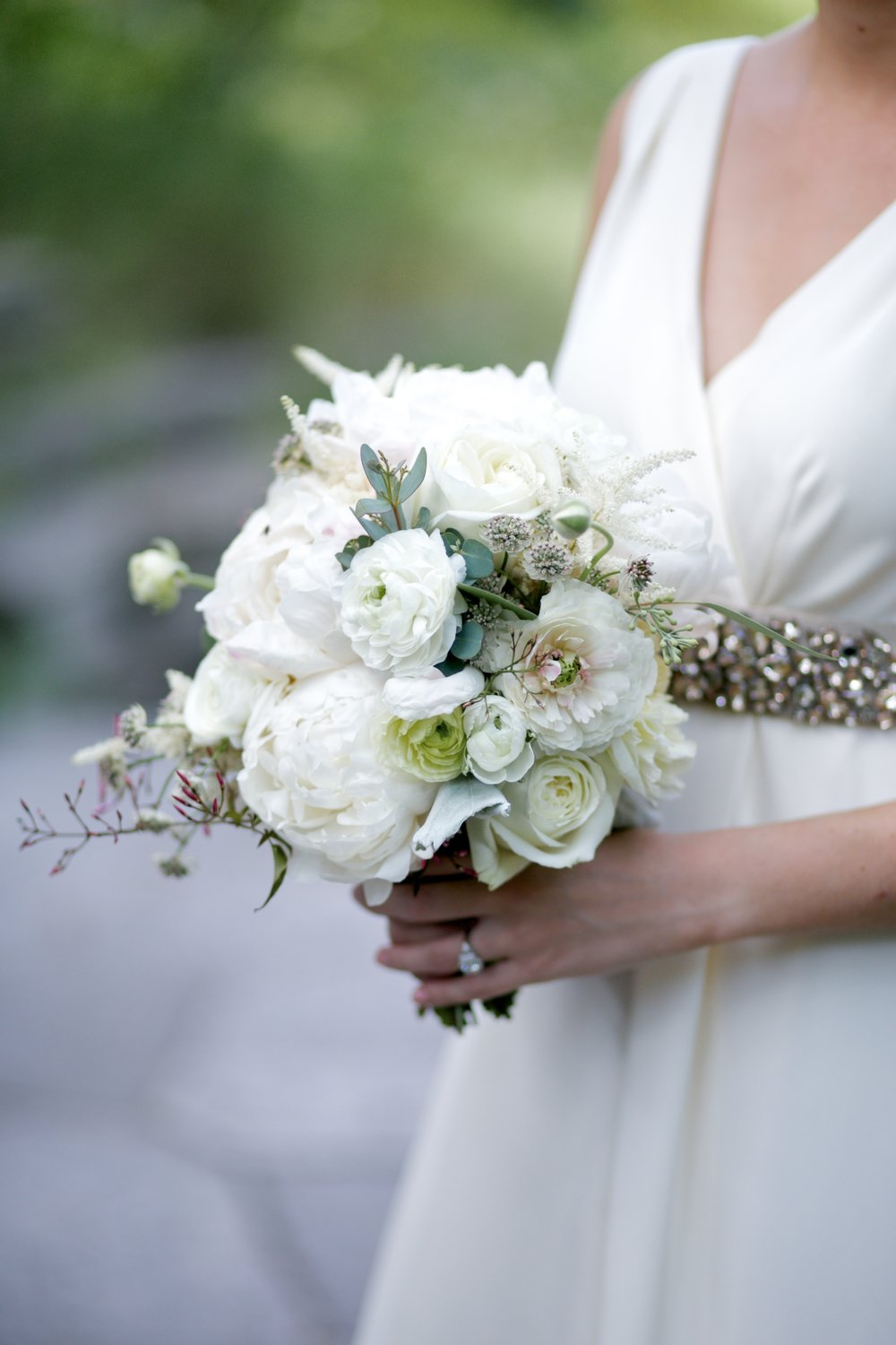 Tailored and romantic wedding bouquet with peonies and ranunculus, designed by Fleur Inc.  Photographed by Jaclyn Simpson Photography at the Peggy Notebaert Nature Museum