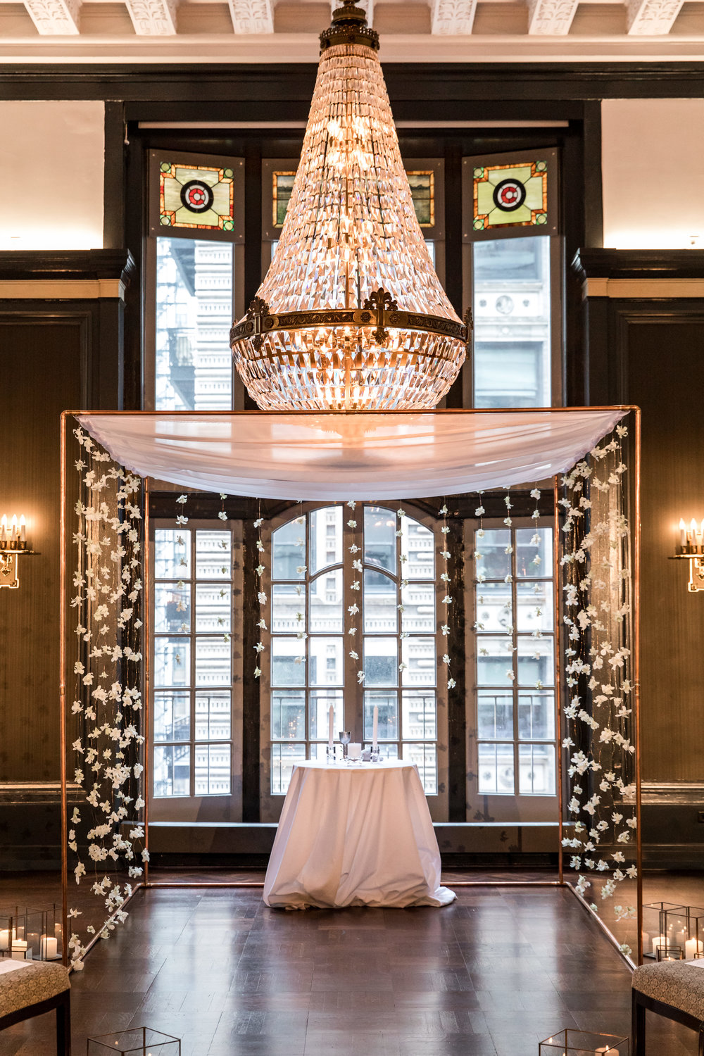 Wedding Flowers by Fleur Inc, Photo by Ann & Kam Photography, Planning by LK Events.  Copper Chuppah with floating orchids at the Chicago Athletic Association.