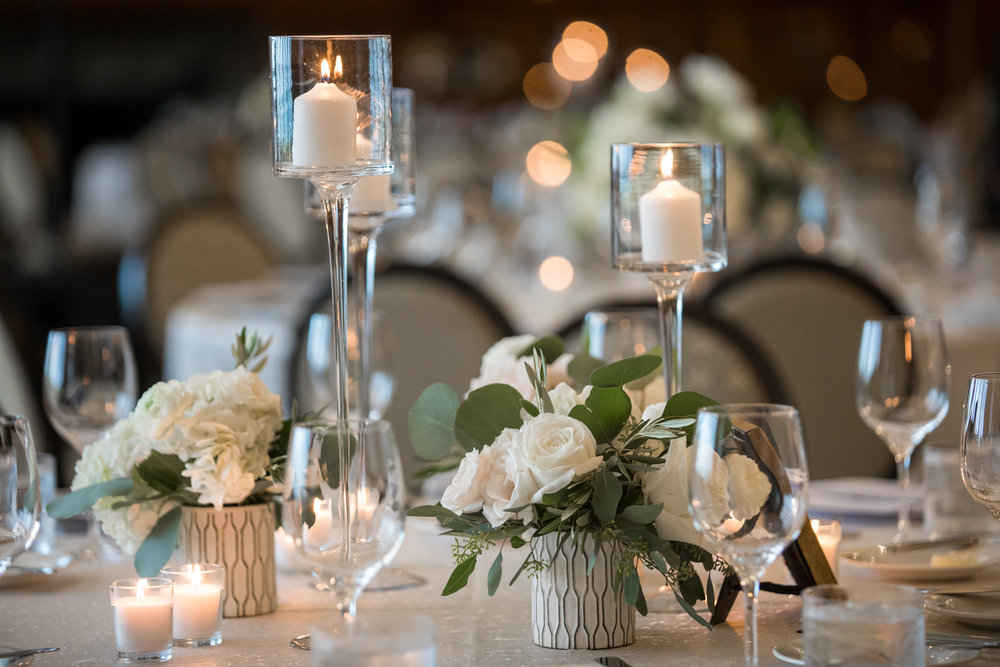 Wedding Flowers by Fleur Inc, Photo by Ann & Kam Photography, Planning by LK Events.  Candle centerpiece at the Chicago Athletic Association.
