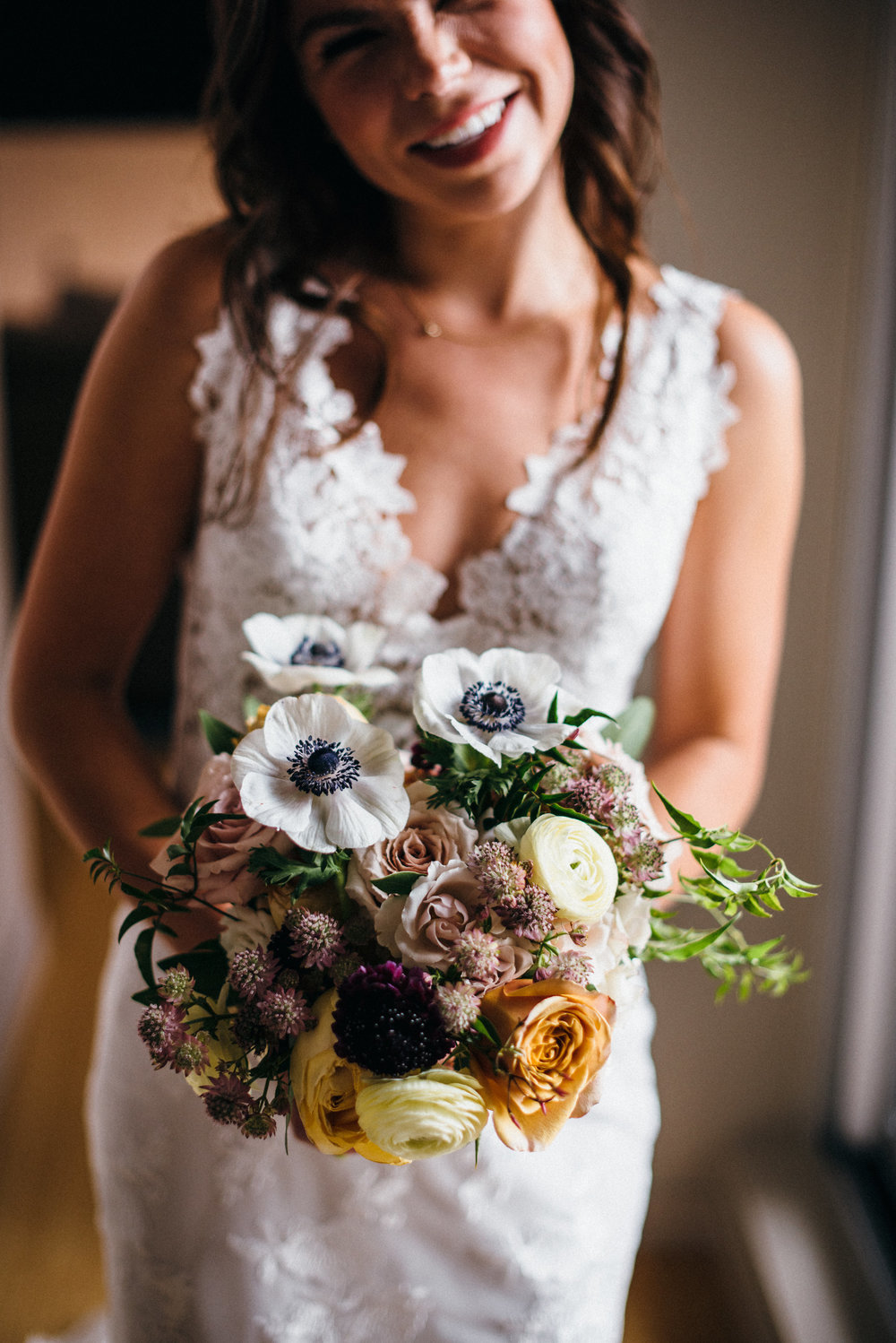 Flowers by Fleur, Photo by Couple of Dudes Photography, Planning by Estera Events at Morgan's on Fulton.  Anemone bridal bouquet.