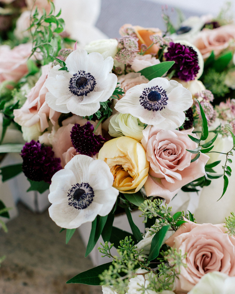 Flowers by Fleur, Photo by Couple of Dudes Photography, Planning by Estera Events at Morgan's on Fulton. Anemone bridesmaid bouquets.