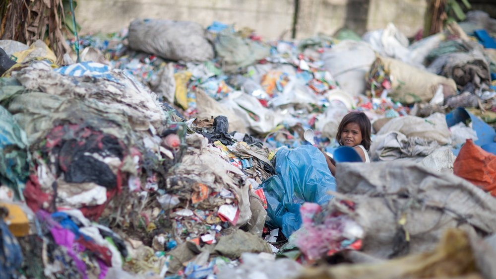Children and their families living in areas surrounding the guatemala city dump.
