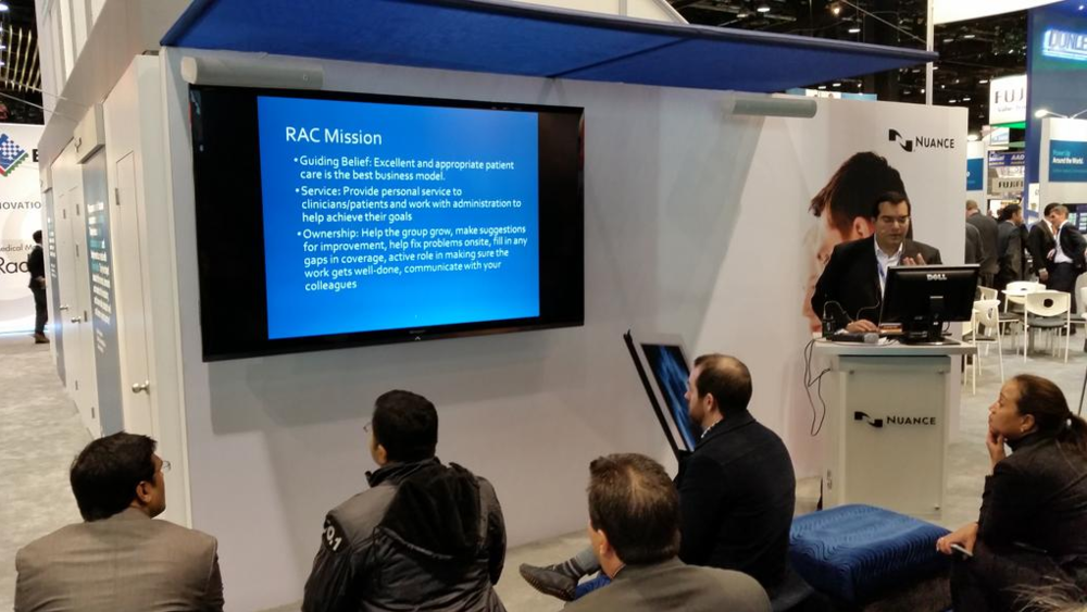 Dr. Zaidi giving a talk on Co-Management at the Nuance booth