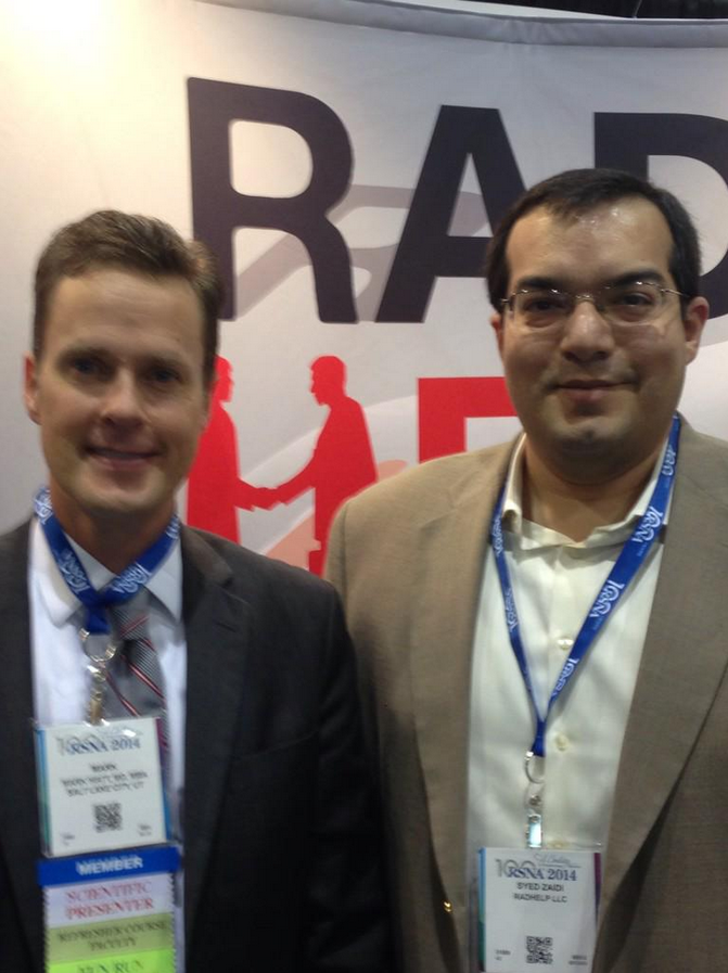 Mark Hiatt visiting with Dr. Zaidi at RadHelp Booth