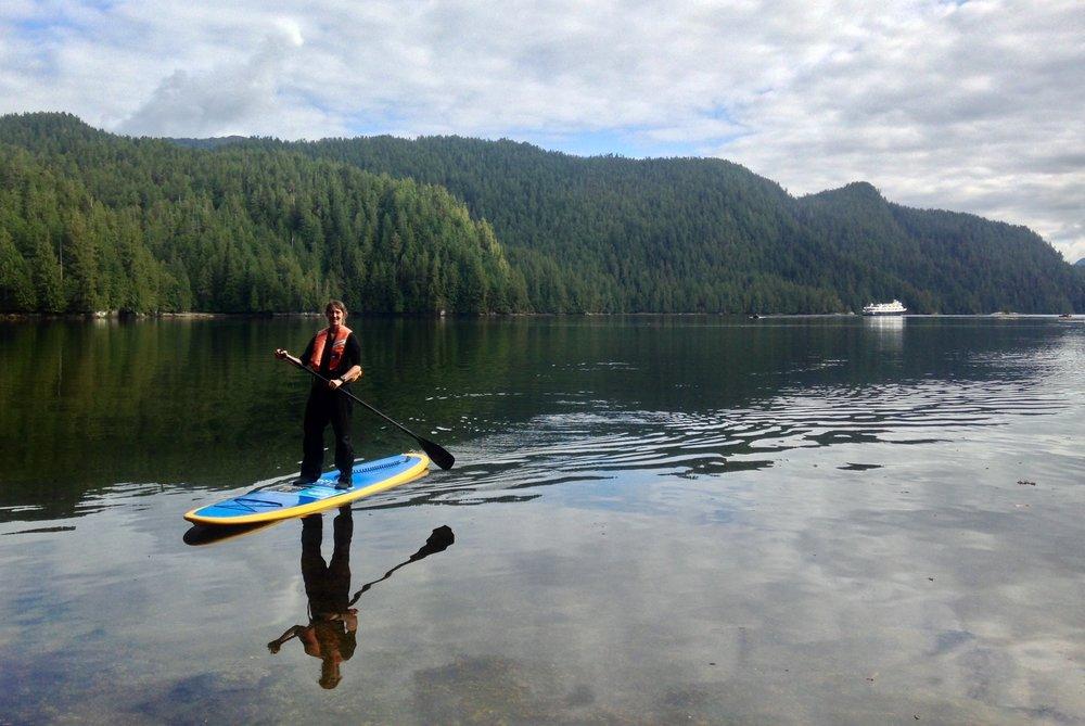 Me standup paddle boarding in Alaska
