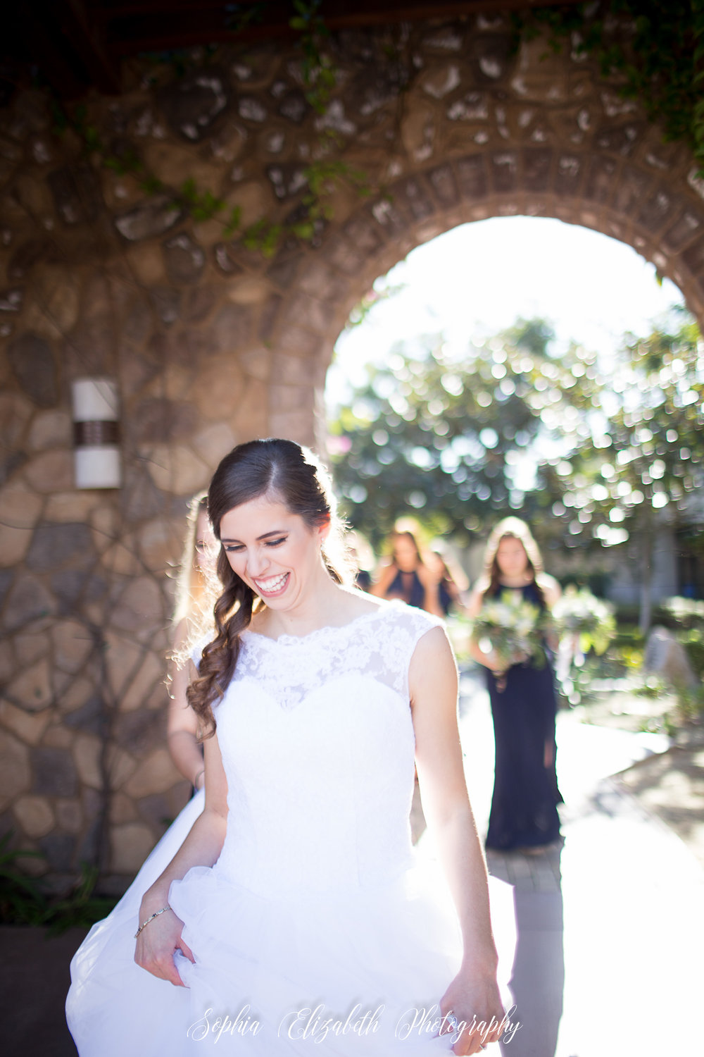 bride-walking-bridesmaids-del-mar-wedding