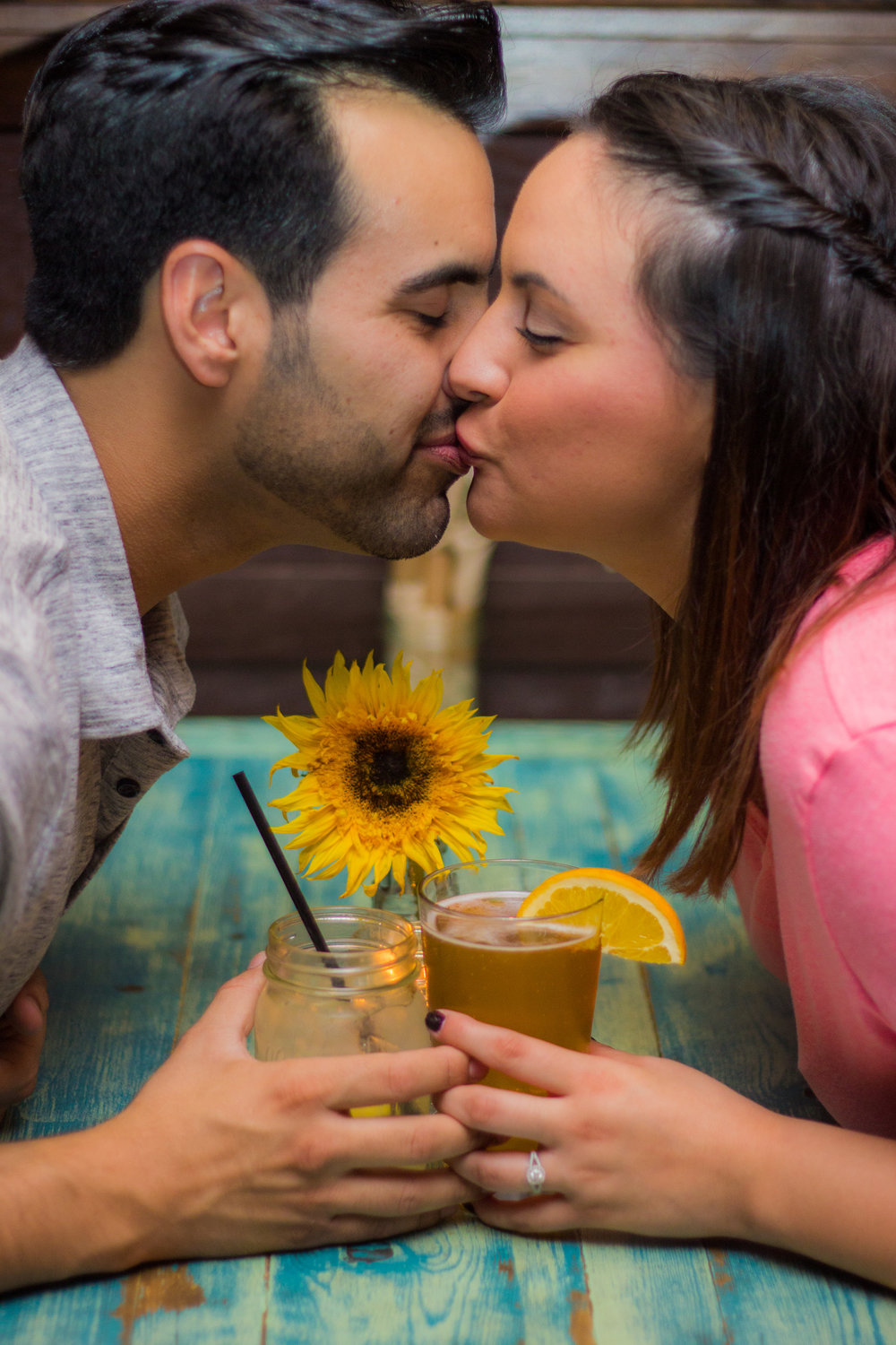 coronado-tavern-restaurant-california-san-diego-wedding-photographer-first-date-recreated-sunflowers-blue-moon-ale-teal-tables-candlelight-booth-by-the-window