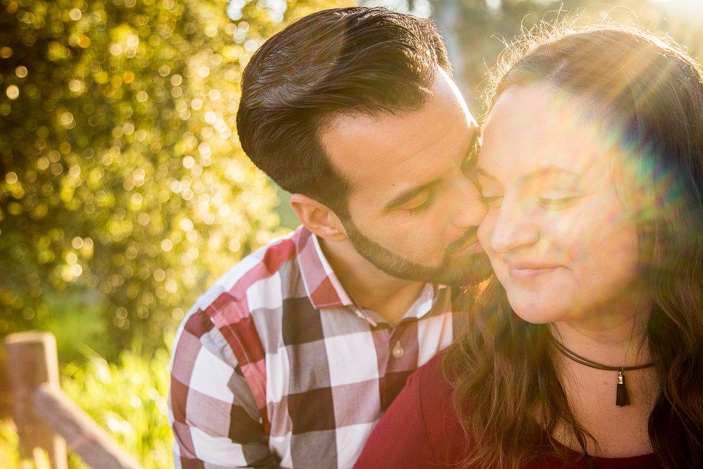 sun-spot-photograph-sunset-golden-hour-engagement-session-san-diego-california-wedding-photographer-kiss-