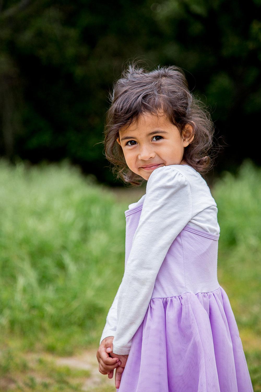 candid-pose-little-girl-purple-dress-princess-pose