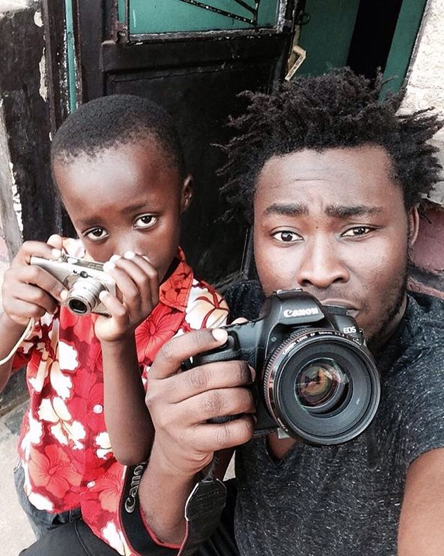 Street photography with Yakubu passing along his skills to the younger generation. Check Yakubu out on VAYANDO.com. #streetphotography #kigali #rwanda