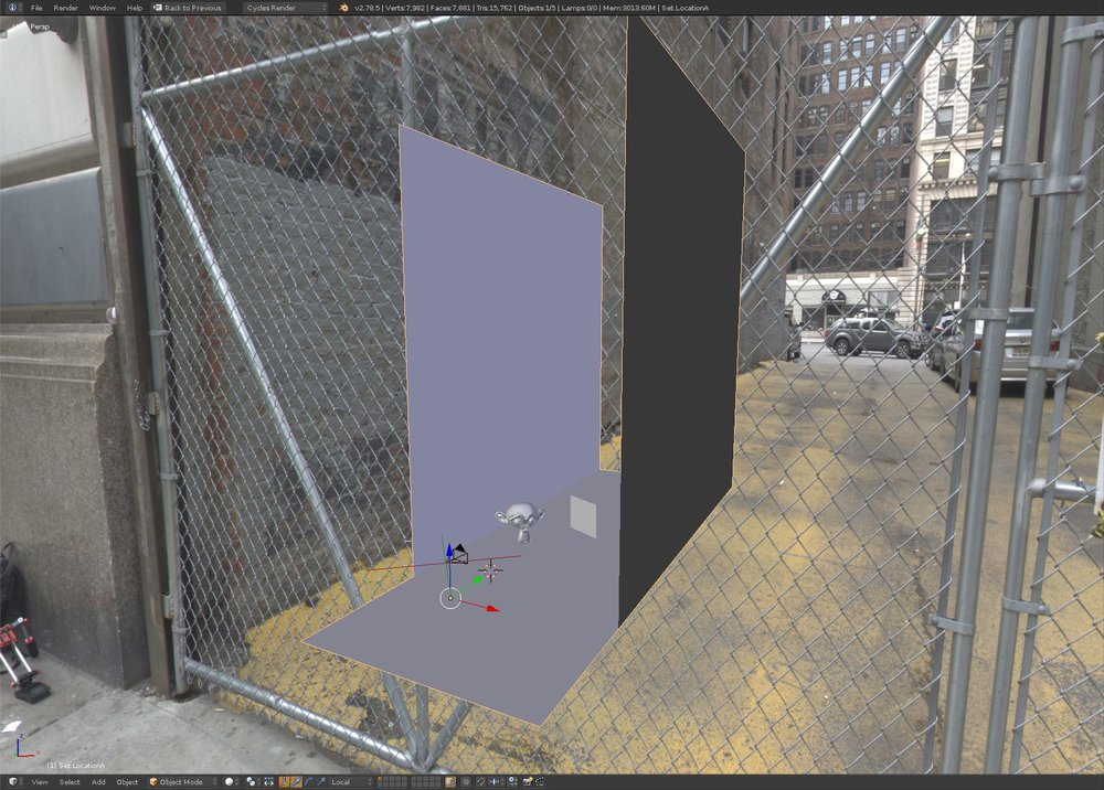 My simple set. Two walls either side of the alleyway, the ground, and the sidewalk. Note the position of Suzanne and a color-checker card.