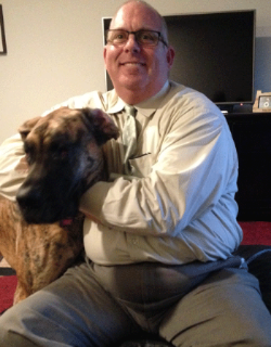 Christopher with his Great Dane, Lily, at their apartment in the Hassalo on Eighth community.