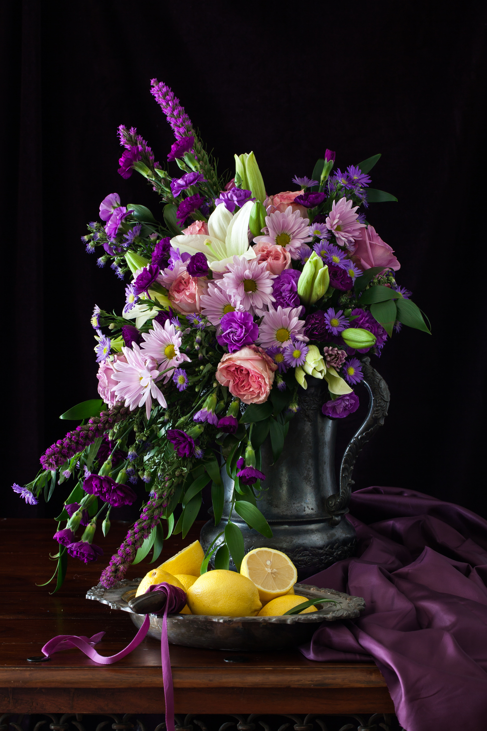 Still life with purple flowers and lemons